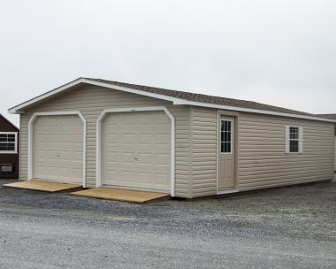 24' x 32' two-car modular garage with vinyl siding and upgraded flooring